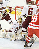 John Muse (BC - 1), Patrick Wey (BC - 6) - The Boston College Eagles defeated the visiting Boston University Terriers 5-2 on Saturday, December 4, 2010, at Conte Forum in Chestnut Hill, Massachusetts.