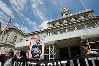 Parents and relatives of the missing 43 students of Ayotzinapa, Mexico, hold a banner with a illustration of Mexico's president Enrrique Pena Nieto while they hold a press conference at the steps of the New York City Hall in New York.  04/22/2015. Eduardo MunozAlvarez/VIEWpress