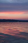 Brilliant pink sunset in summer on Lake Michigan in Traverse City, Michigan, MI, USA