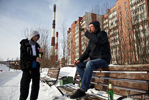 Men enjoy a beer on a Sunday afternoon in Murmansk, the world's largest Arctic city, in northern Russia.