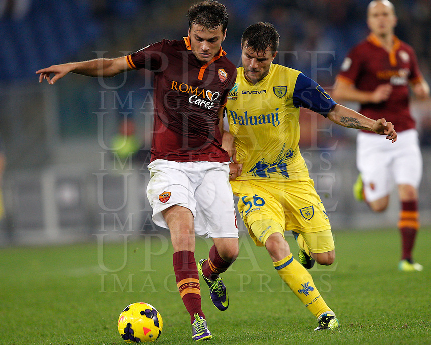 Calcio, Serie A: Roma vs ChievoVerona. Roma, stadio Olimpico, 31 ottobre 2013.<br /> AS Roma forward Adem Ljajic, of Serbia,  is challenged by ChievoVerona midfielder Perparim Hetemaj, of Finland,  right, during the Italian Serie A football match between AS Roma and ChievoVerona at Rome's Olympic stadium, 31 October 2013.<br /> UPDATE IMAGES PRESS/Riccardo De Luca