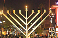Rabbi Eli Levitansky,  from the Chabad House, lights the giant Menorah at the Third Street Promenade during the first night of Chanukah on Tuesday, December 20, 2011.