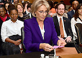 Betsy DeVos of Grand Rapids, Michigan looks over a card prior to appearing before the United States Senate Committee on Health, Education, Labor and Pensions holds a confirmation hearing considering her nomination to be US Secretary of Education on Capitol Hill in Washington, DC on Tuesday, January 17, 2017.<br /> Credit: Ron Sachs / CNP