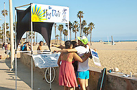 Free hugs were offered at the Hug Deli at the Santa Monica boardwalk on Sunday, June 3, 2012.