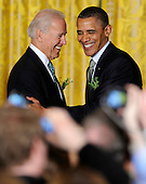 United States President Barack Obama (R) is welcomed by US Vice President Joe Biden as he arrives for a reception for Irish Prime Minister Enda Kenny in the East Room of the White House, March 20, 2012, in Washington, DC. Obama and Kenny  concluded a working day devoted to discussions on economic matters, Ireland's peace keeping participations and foreign policy issues like Syria and Iran. .Credit: Mike Theiler / Pool via CNP
