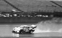 The #24 Porsche of Marion Speer, Ken Madren, and Ray Ratcliff leaves a rooster tail as  it races in the rain during the 1983 24 Hours of Daytona , Daytona Internationa Speedway, Daytona Beach, FL, February 1-2, 1983.  (Photo by Brian Cleary / www.bcpix.com)