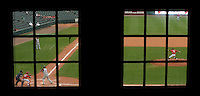 Gary Cosby Jr./ Decatur Daily     Hartselle High won its eighth state championship defeating Spanish Fort 3-2 at Riverwalk Stadium in Montgomery.  Hartselle's Easton Chenault is framed by windows in the stadium as Spanish Fort's Jesse McCord delivers a pitch during the championship game.