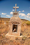 Cemetery and headstones behind the burned walls of San Ysidro Church in Las Mesitas. Colorado.