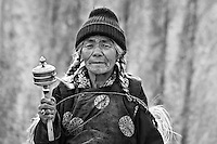 Woman with Prayer Wheel at Lamayuru, Jammu and Kashmir, India