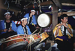 Musicians perform inside the massive wagons during the Colliding Float Festival in Kakunodate, Japan. Each of the 15 massive five-ton wooden wagons, decorated to look like a sacred mountain, are pushed and pulled throughout the narrow streets of this samauri town. When meeting one another in opposite directions, a negotiation team is sent out to haggle over right of way. If this fails, the wagons are then crashed into one another. The Colliding Float Festival dates back to the 18th century when residents in this small farming village held a three-day festival in September to honor the gods for a bountiful harvest. (Jim Bryant Photo).....