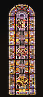 One of the seven stained glass windows of the absid, by Louis Barillet, 20th century, Nanterre Cathedral (Cathédrale Sainte-Geneviève-et-Saint-Maurice de Nanterre), 1924 - 1937, by architects Georges Pradelle and Yves-Marie Froidevaux, Nanterre, Hauts-de-Seine, France. Every window describes with three symbols one scene of the Passion : the Eucharist, Agony in the Garden, the Sanhedrin trial of Jesus (Christ Before Caiaphas), Pilate's court, crucifixion of Jesus, the entombment of Christ, the Resurrection of Christ.  Picture by Manuel Cohen