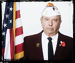 Veteran Johnny Swain poses for a photo at a Veterans Day Program at the Oxford Conference Center in Oxford, Miss. on Thursday, November 11, 2010.