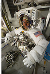 S131-E-008661 (11 April 2010) --- NASA astronaut Rick Mastracchio, STS-131 mission specialist, attired in his Extravehicular Mobility Unit (EMU) spacesuit, is pictured in the Quest airlock of the International Space Station prior to the start of the mission's second spacewalk.
