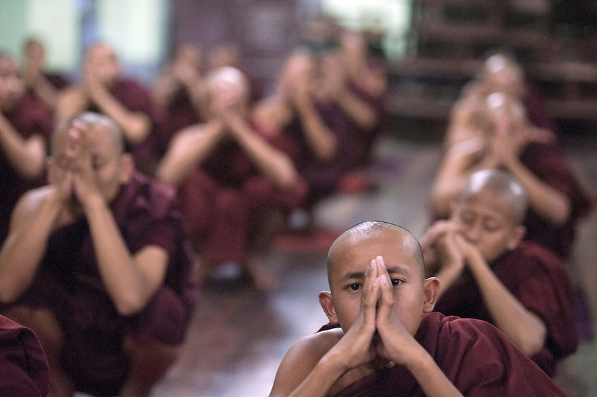 Novice monks pray at Mae Soe Yein monastery in Mandalay.  Ashin Wirathu, one of the head monks at the monastery, is the most vocal advocator of  the 969 movement that encourages Buddhists to only shop at Buddhist owned shops with stickers to identify them.