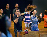STAFF PHOTO BEN GOFF  @NWABenGoff -- 10/26/14 Ckristian (CQ) Velez, daughter Nicole Velez, 3, and wife Rebecca Velez attend the contemporary Spanish language service at the First Baptist Church of Rogers Olive Street campus on Sunday October 26, 2014. The church has reopened its old downtown location and now offers an English language service at 9:00a.m. as well as the Spanish service at 11:30a.m. in an effort to  'intentionally pursue and celebrate ethnic diversity,' according to the church's website.