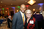 Waterbury, CT- 21 March 2017-032117CM09-  SOCIAL MOMENTS---  From left, master of ceremonies, Darren Haynes host of Sports Center at ESPN with Lynn Curless development director at  The Children's Community School Board are photographed during the annual of Directors Awards Dinner at La Bella Vista in Waterbury on Tuesday.   Christopher Massa Republican-American