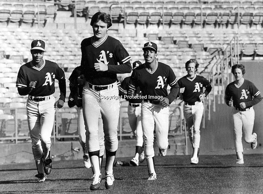 Oakland Athletics warm up before game, pitcher Dave Beard center leads runners. (1983 photo/Ron Riesterer)