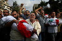 Beirut, Lebanon, Aug 9 2006.Shiyah neighbourhood, Makhbar e Shahideen cemetery, Men carry their dead children and grandchildren during the funeral of the 39 civilians, many of them women and children, killed on August 7th, when Israeli bombs levelled an appartment building in this non-Hezbollah suburb of Beirut, without any apparent reason.