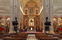The Capilla Mayor, or chancel, built 1523, with huge 18th century neoclassical altarpiece by Alonso Matias with 5 paintings by Antonio Palomino and sculptures by Pedro de Paz, in the in the 16th century cathedral within the Cathedral-Great Mosque of Cordoba, in Cordoba, Andalusia, Southern Spain. Either side are 2 mahogany pulpits by Verdiquier with a bull, lion and eagle in marble. The first church built here by the Visigoths in the 7th century was split in half by the Moors, becoming half church, half mosque. In 784, the Great Mosque of Cordoba was begun in its place and developed over 200 years, but in 1236 it was converted into a catholic church, with a Renaissance cathedral nave built in the 16th century. The historic centre of Cordoba is listed as a UNESCO World Heritage Site. Picture by Manuel Cohen