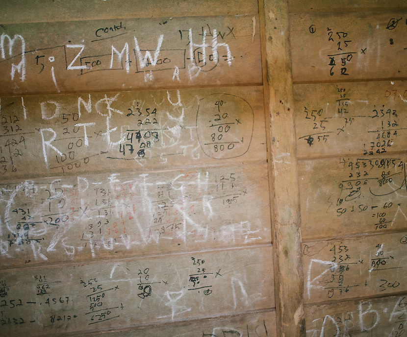 Student writing on the jungle school wooden wall. The Mentawai are the tribes living traditionally in the island of Siberut, Indonesia. Here, where the changes came slow, some of the people are still living like their ancestors did centuries ago. They s till practice ancient religion called Arat Sabulungan, which believe that everything in the forest has a spirit.
