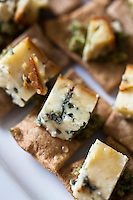 Stilton cheese drizzled with honey on whole-grain crackers..