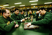 Mike Prior, Mark Chmura, Bill Schroeder, Jim McMahon and Frank Winters play games in the locker room on Jan. 9, 1997.