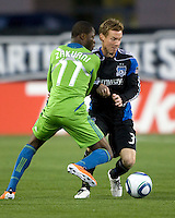 Chris Leitch of Earthquakes fights for a loose ball against Steve Zakuani during the game at Buck Shaw Stadium in Santa Clara, California on April 2nd, 2011.   San Jose Earthquakes and Seattle Sounders are tied 2-2.