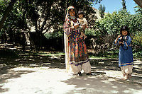 A woman and two daughters, on the road to the Menar e Jam in the Ghor province - Afghanistan. .From western Afghan capital Herat to the former capital of the Ghorides Empire Fîrûzkôh, next to the Menar e Jam..-The full text reportage is available on request in Word format