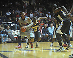 "Ole Miss guard Trevor Gaskins (23)  dribbles past Southern Mississippi guard Angelo Johnson (23) to score at C.M. ""Tad"" Smith Coliseum in Oxford, Miss. on Saturday, December 4, 2010."