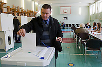 Moscow, Russia, 04/03/2012..A man casts his ballot on a basketball court as Russians vote in the Presidential election, which Prime Minister Vladimir Putin is expected to win in the first round.