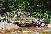 Remnants of a timber trestle that once spanned the East Branch of the Pemigewasset River in the area of Camp 18 along the East Branch & Lincoln Railroad (1893-1948) in the Pemigewasset Wilderness of Lincoln, New Hampshire.
