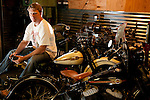 Motorcycle builder on antique Harley Davidsons.