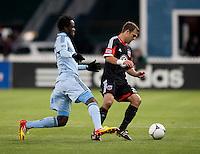 Kei Kamara, Daniel Woolard.  Sporting KC defeated D.C. United, 1-0, at RFK Stadium in Washington, DC.
