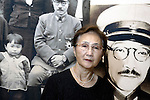 """Yuko Tojo, granddaughter of Japan's wartime leader, General Hideki Tojo, poses with a photo of her grandfather outside Yaskuni Shrine in Tokyo. Gen. Hideki Tojo - who ordered the attack on Pearl Harbor -- was charged and hanged as a war criminal after World War II when Yuko was just 6, and he is enshrined inside the controversial Yasukuni Shrine together with 13 other convicted war criminals. Though she remembers little of her grandfather she still regards him as a hero. """"Japan did not fight a war of aggression but in self-defense,"""" says Ms. Tojo, widely seen as a leading figurehead in a recent surge in nationalism in Japan and who unsuccessfully ran for a seat in Japan's House of Councilors in 2007. """"Japanese children are only taught about the evil things our country and their ancestors did during the war and this has led to a lack of pride in the Japanese people, which is wrong. We must reinstall a sense of pride and confidence in our children."""""""
