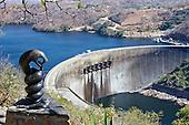 Kariba Dam wall being over looked by Nyami Nyami, the river God.