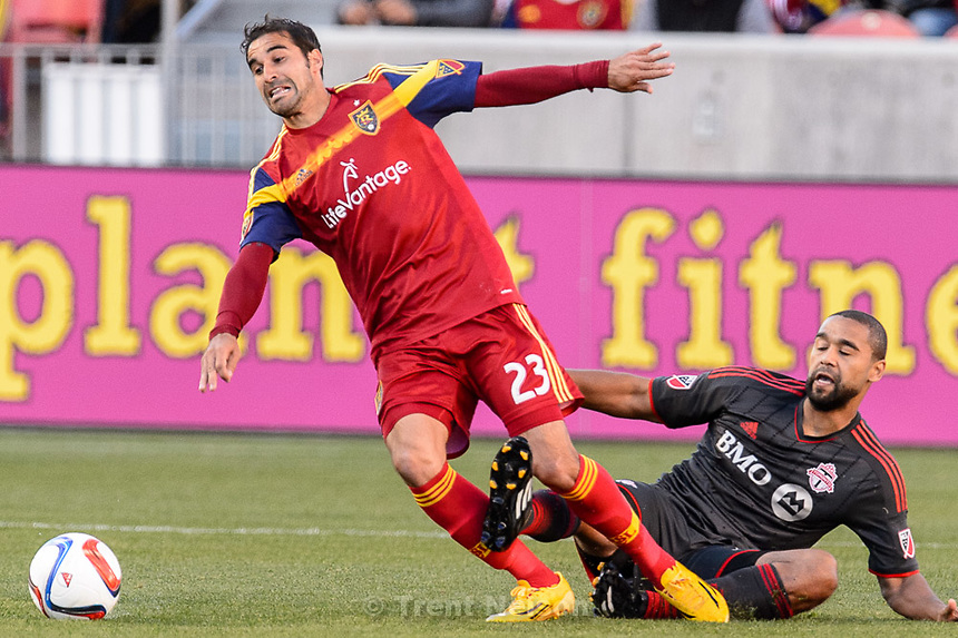 Trent Nelson  |  The Salt Lake Tribune<br /> Toronto FC forward Luke Moore (27) fouls Real Salt Lake forward Sebastian Jaime (23) as Real Salt Lake hosts Toronto FC at Rio Tinto Stadium in Sandy, Sunday March 29, 2015.