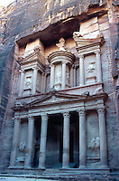 "Jordan. Petra. The archeological site is part of the UNESCO world heritage project.  The Nabateans were an arabian industrious tribe which settled down in southern Jordan 2000 years ago. Petra is located at the bottom of a spectacular deep gorge surrounded by mountains. After walking down the ""Siq"", a narrow and long path through a fault due to a prehistoric earthquake, tourists discover the fist building ""El Khazneh"". Its high façade is carved in the rocks.  At sunset.  © 2002 Didier Ruef"