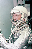 Astronaut John H. Glenn Jr. dons his silver Mercury pressure suit in preparation for launch. On February 20, 1962 Glenn lifted off into space aboard his Mercury Atlas (MA-6) rocket and became the first American to orbit the Earth. After orbiting the Earth 3 times, Friendship 7 landed in the Atlantic Ocean 4 hours, 55 minutes and 23 seconds later, just East of Grand Turk Island in the Bahamas. Glenn and his capsule were recovered by the Navy Destroyer Noa, 21 minutes after splashdown..Credit: NASA via CNP