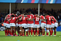 The Tonga team huddle together after the match. Rugby World Cup Pool C match between Tonga and Namibia on September 29, 2015 at Sandy Park in Exeter, England. Photo by: Patrick Khachfe / Onside Images