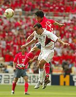Landon Donovan leaps for a header. The USA tied South Korea, 1-1, during the FIFA World Cup 2002 in Daegu, Korea.