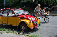 Members of the Greater New York Citorën and Velosolex Touring Club bring out their lovingly restored Citroën automobiles for their Bastille Day Rendez-Vous, seen on Riverside Drive in New York on Sunday, July 14, 2013. The parade of over a dozen Citroëns, including 2CV, DB series models, a truck and a traction avant started on Riverside Drive and traveled through the streets of Manhattan. The owners are dedicated to restoring and caring for their vehicles and share tips and information on repairing and restoring them. (© Frances M. Roberts)Members of the Greater New York Citorën and Velosolex Touring Club bring out their lovingly restored Citroën automobiles for their Bastille Day Rendez-Vous, seen on Riverside Drive in New York on Sunday, July 14, 2013. The parade of over a dozen Citroëns, including 2CV, DB series models, a truck and a traction avant started on Riverside Drive and traveled through the streets of Manhattan. The owners are dedicated to restoring and caring for their vehicles and share tips and information on repairing and restoring them. (© Frances M. Roberts)