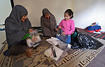 Souad Kasem Issa and her daughters Rawan, 10, and Rahaf, 9, open hygiene kits provided by International Orthodox Christian Charities. They are Syrian refugees living in Amman, Jordan. The family of eight fled the city of Homs as fighting there worsened in 2012. Their home in Syria has since been destroyed by bombing, and they are struggling to survive in Jordan's capital city. The IOCC is a member of the ACT Alliance. The hygiene kits include a towel, soap, toothbrush, comb, and other items.