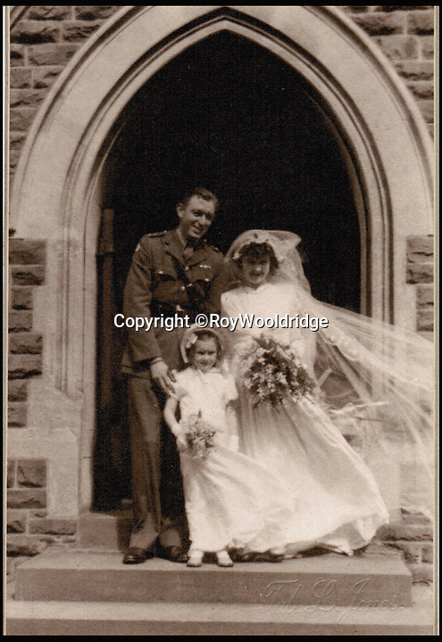 BNPS.co.uk (01202 558833)<br /> Pic: RoyWooldridge/BNPS<br /> <br /> ***Please Use FullByline***<br /> <br /> Roy Wooldridge and Phyllis (nee Williams) on their wedding day, 5th May 1944. Mary Rosser, a cousin to Roy stands as a flower girl. <br /> <br /> The incredible story of how legendary German general Erwin Rommel spared the life of a captured British soldier and then served him a glass of beer has been revealed after 70 years.<br /> <br /> Captain Roy Wooldridge met Rommel after being taken prisoner in a dangerous night-time mission to examine submerged mines along the French beaches weeks before the D-Day landings.<br /> <br /> His story is to be told on BBC1's Antiques Roadshow this Sunday.