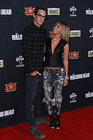 UNIVERSAL CITY, CA, USA - OCTOBER 02: Ashley Tisdale, Christopher French arrive at the Los Angeles Premiere Of AMC's 'The Walking Dead' Season 5 held at AMC Universal City Walk on October 2, 2014 in Universal City, California, United States. (Photo by David Acosta/Celebrity Monitor)