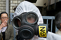 April 10, 2011 - A man with a gasmask waits for an anti-nuclear rally to start at Koenji Chuo park in Koenji, Tokyo, Japan..According to the organisers 15,000 attended the protest more conservative estimates put the number at 5000. (Photo by B.Meyer-Kenny/2.0 images)