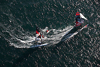 Extreme Sailing Series 2011. Leg 1. Muscat. Oman.Day 1 of racing. Team New Zealand and Team Extreme round the mark