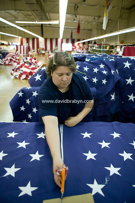 21 June 2005 - Oaks, PA - Karen Hipple separates fields - the starred part of an American flag - at the Annin & Co. flag manufacturing plant in Oaks, PA. Photo Credit: David Brabyn.