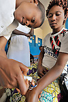 A nurse treats a patient in a clinic of the United Methodist Church in Kananga, a town in the Democratic Republic of the Congo.