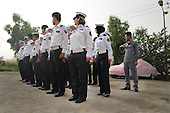 Hasiba Jasni, 36,  is a traffic policewoman. She works five days a week and cares for her 4 year-old son while pregnant with her second child. She has recently been refitted for a new uniform because of her pregnancy. Every day she prepares three meals for her husband, Omed Rashid, who owns a teahouse and has a second wife that he visits infrequently. She and her family currently rent their house now but are saving money for a home of their own.
