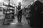 Saltaire Yorkshire England. Salts Cottton Mill factory worker. 1981
